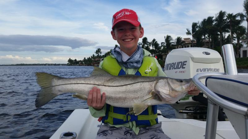 Click image for larger version.  Name:Gs 1st big snook.jpg Views:149 Size:53.9 KB ID:157993